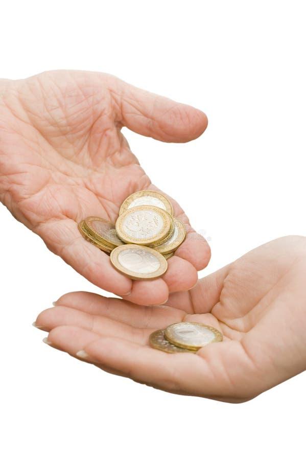 Monedas de las viejas manos imágenes de archivo libres de regalías