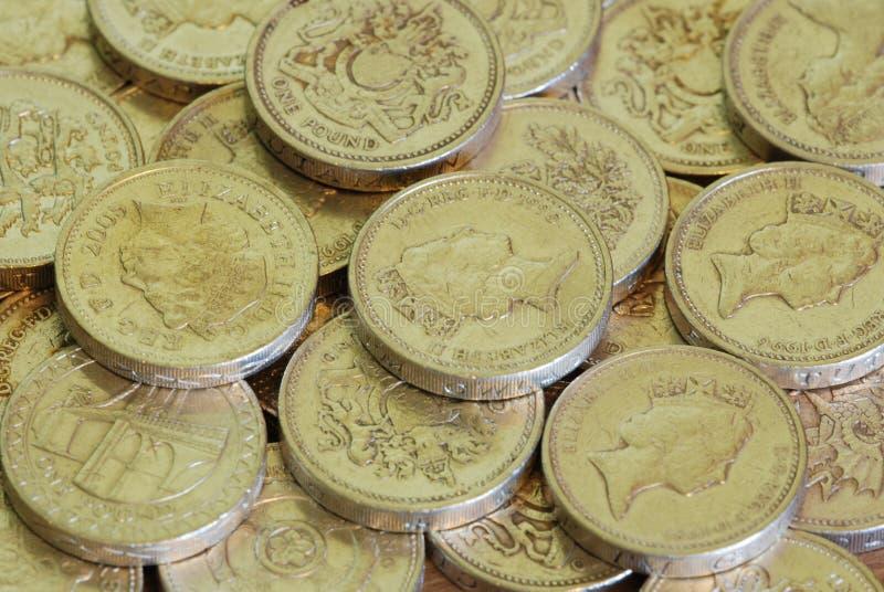 Monedas de una libra imagen de archivo