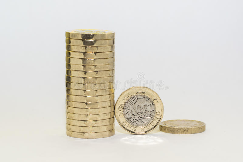 Monedas de una libra nuevas y viejas foto de archivo