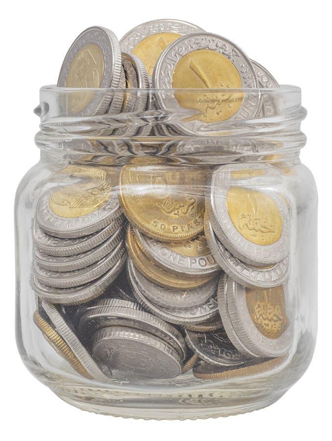 Monedas en Jar, libras egipcias fotografía de archivo