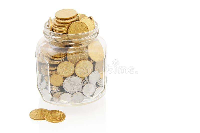 Monedas en tarro imagen de archivo libre de regalías