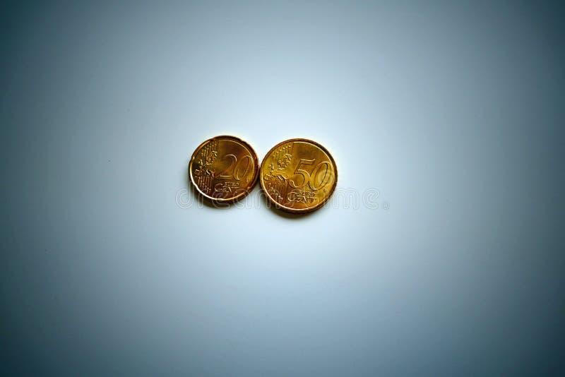 Monedas euro - 20 centavos y 50 centavos fotografía de archivo libre de regalías
