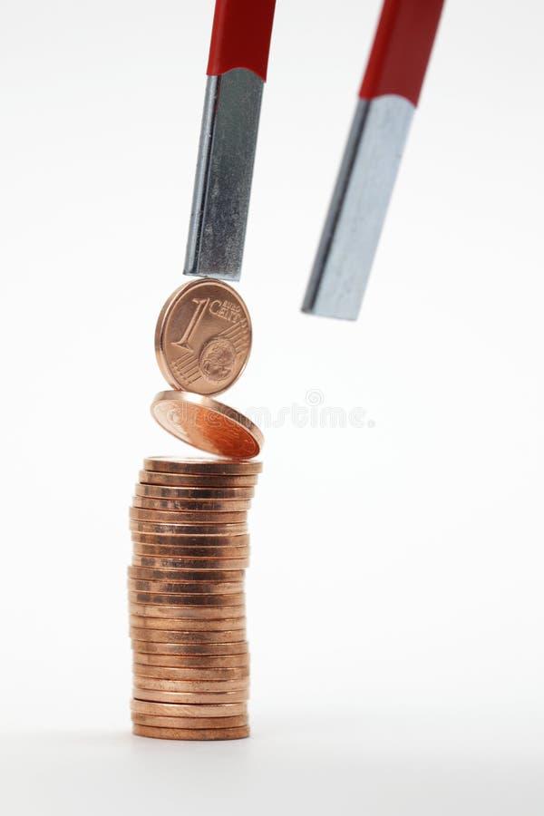 Monedas euro con el imán foto de archivo libre de regalías