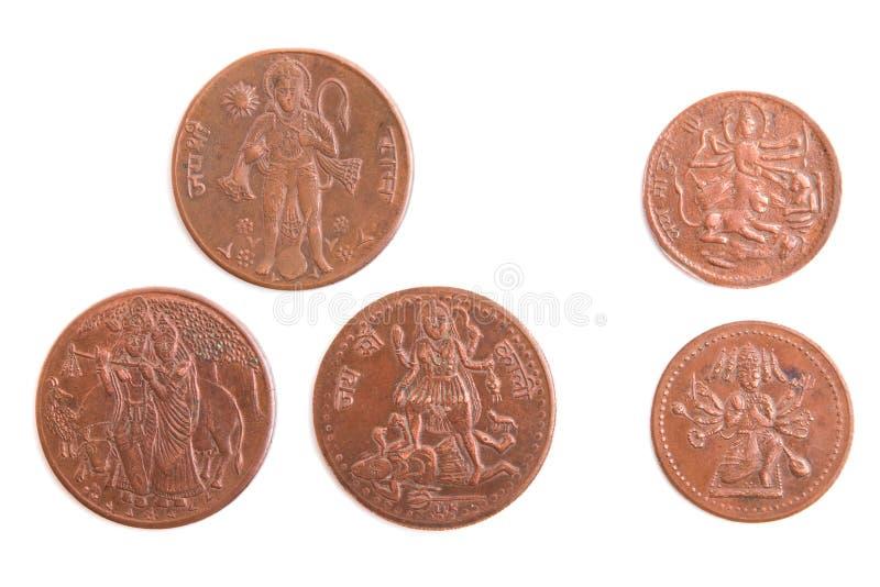 Monedas indias con la imagen de dioses antiguos imagen de archivo