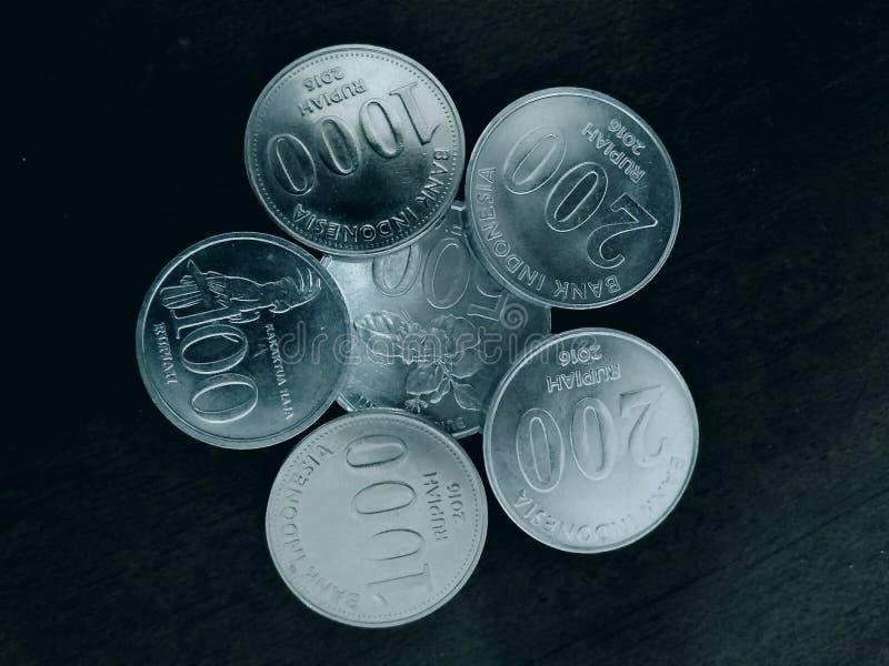 Monedas indonesias imagenes de archivo
