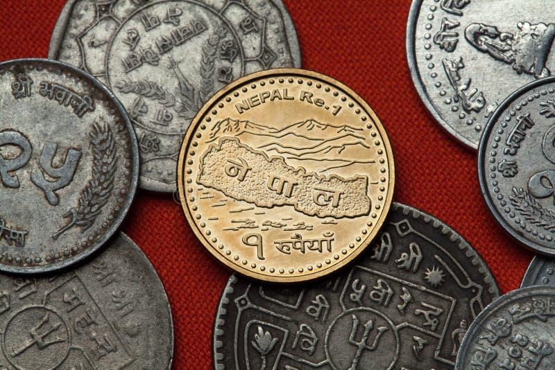 Monedas nepalesas Mapa de Nepal y del Himalaya imagen de archivo libre de regalías