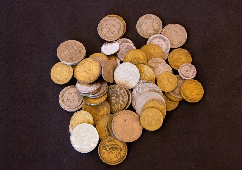 Monedas viejas juntadas imagenes de archivo