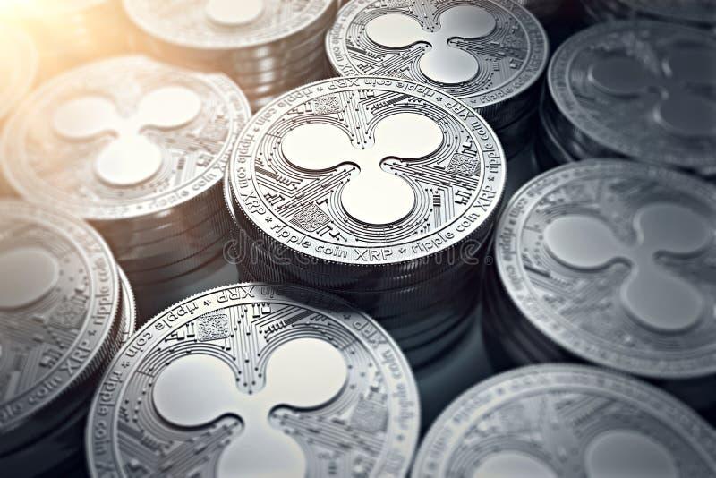 Monedas XRP de la ondulación en primer borroso con la llamarada del sol
