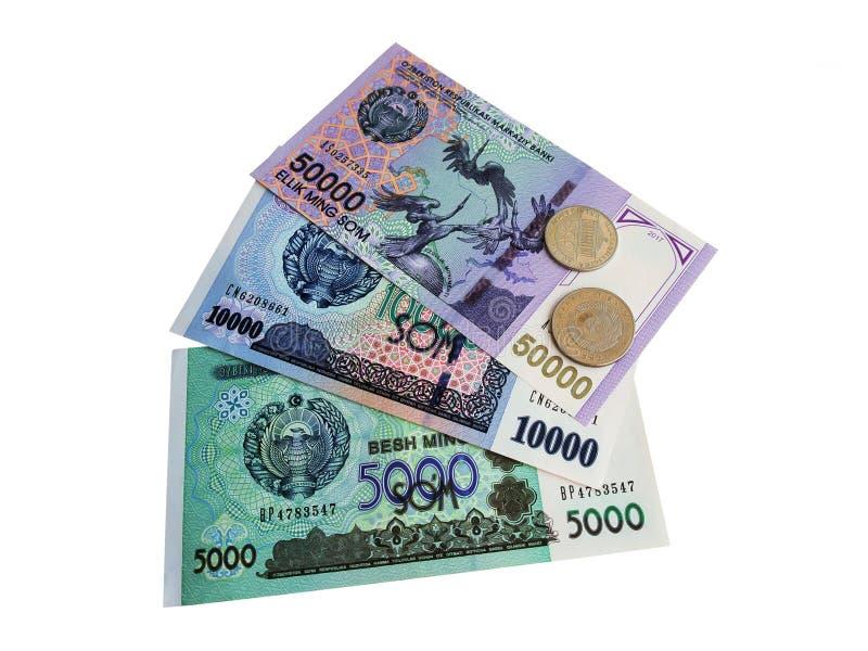 Monedas y billetes de banco de Uzbekistán fotos de archivo