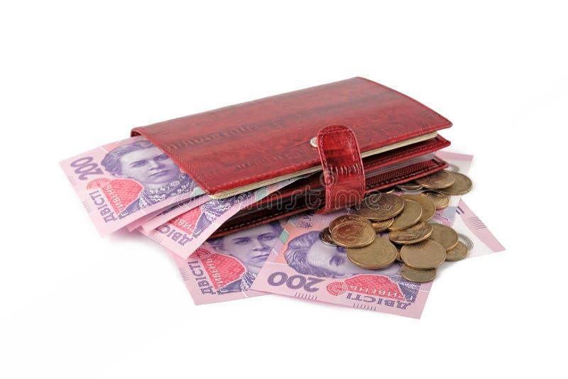 Monedero de cuero rojo con el dinero foto de archivo libre de regalías