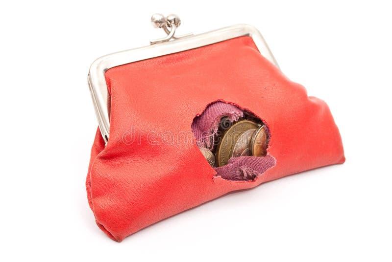 Monedero rojo con el agujero imágenes de archivo libres de regalías