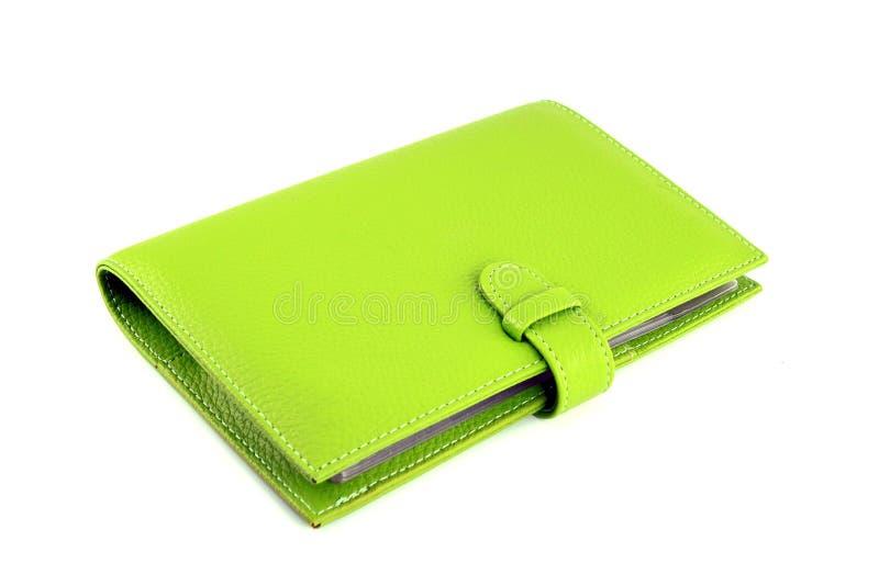 Monedero verde en un blanco fotos de archivo libres de regalías