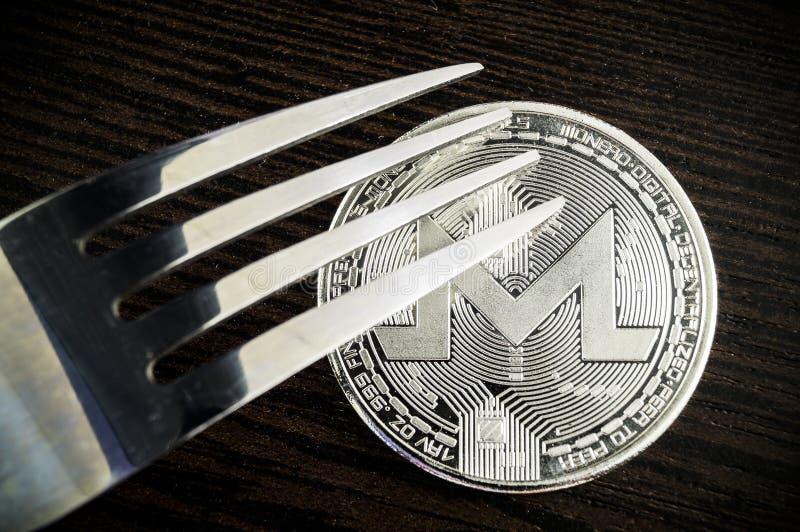 Monero is een moderne manier van uitwisseling en deze crypto munt stock fotografie