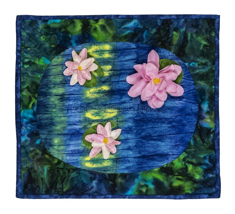 Monet Water Lily Quilt. Monet Water Lily Autumnal flowers and leaves theme quilt, on squares of material framed royalty free stock images