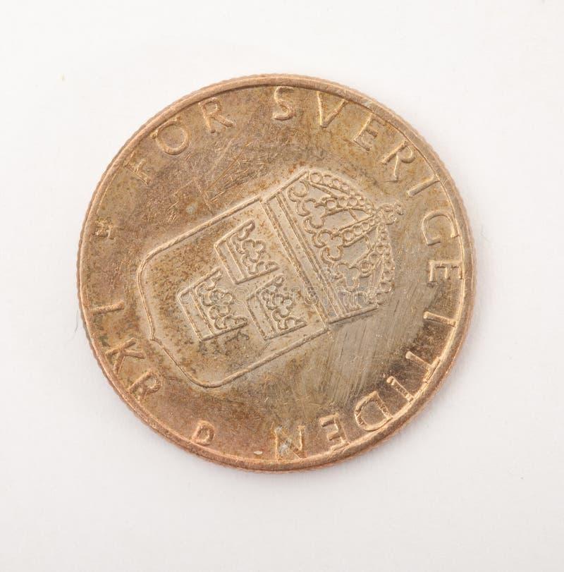 Moneta d'annata del metallo nel fondo bianco fotografie stock libere da diritti
