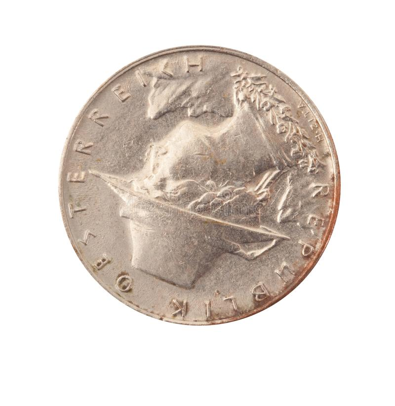 Moneta d'annata del metallo nel fondo bianco fotografia stock