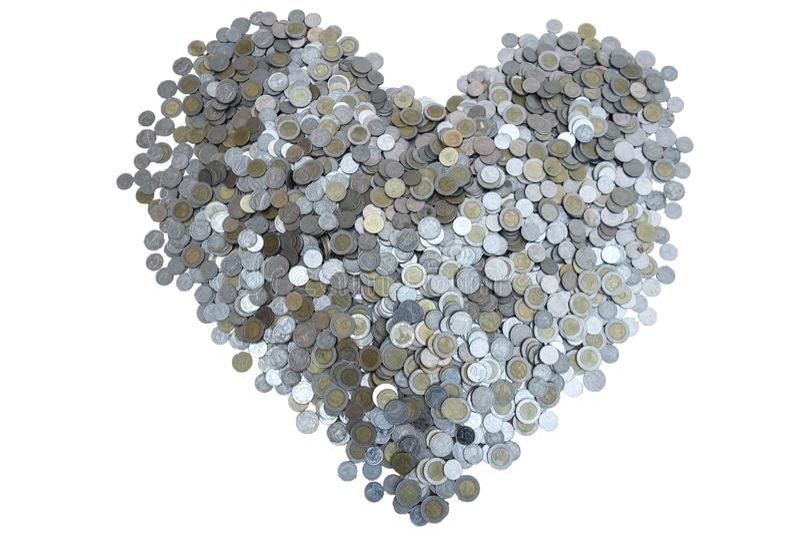 Moneta dei lotti di baht tailandese sistemata nella forma del cuore sopra con struttura bianca del fondo, l'investimento ed il co immagine stock