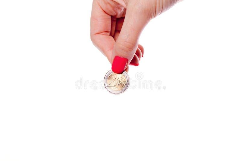 Moneta dell'euro della tenuta della mano della donna fotografie stock libere da diritti