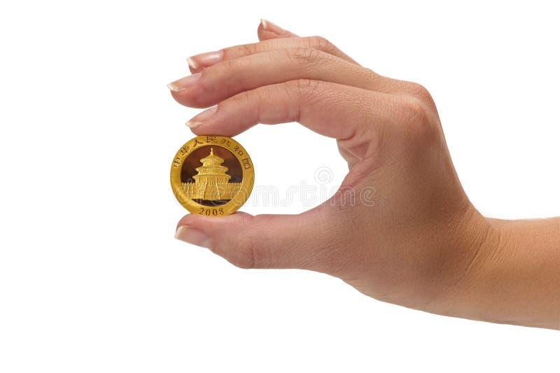 Moneta della holding della donna immagine stock