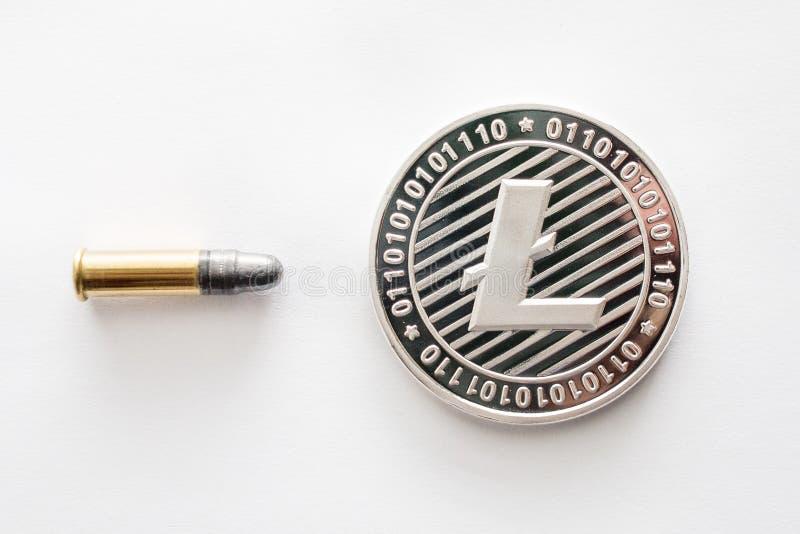 Moneta di Litecoin con una pallottola immagini stock libere da diritti