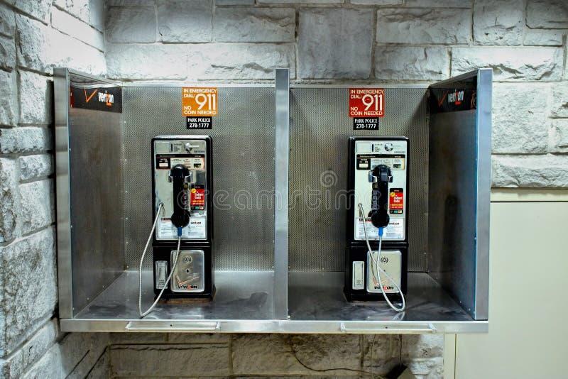 Moneta Działający telefon fotografia stock