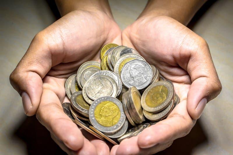 Moneta tailandese a disposizione fotografia stock