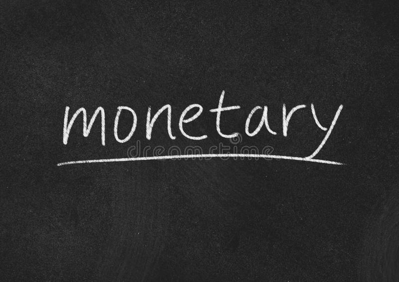 Monetary. Concept word on blackboard background stock images