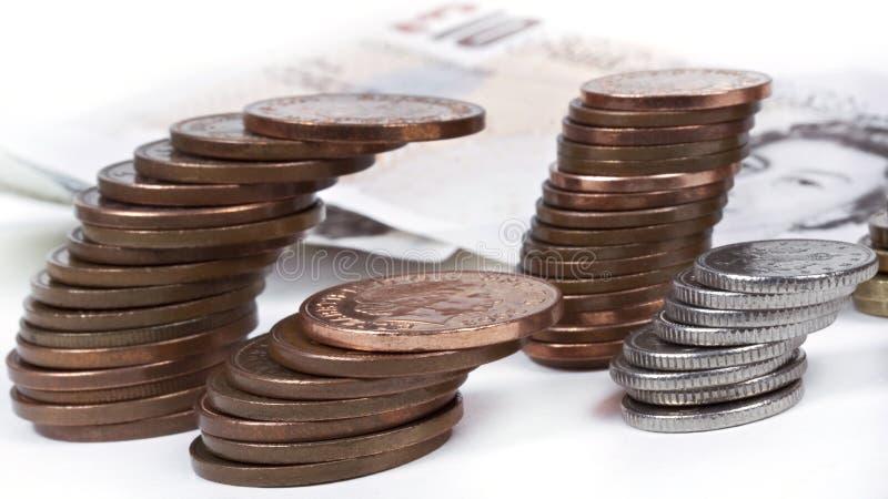 Monete britanniche di penny, fotografia stock libera da diritti