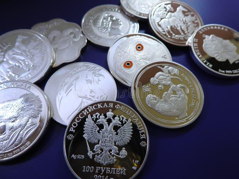 Monete d'argento false fotografie stock