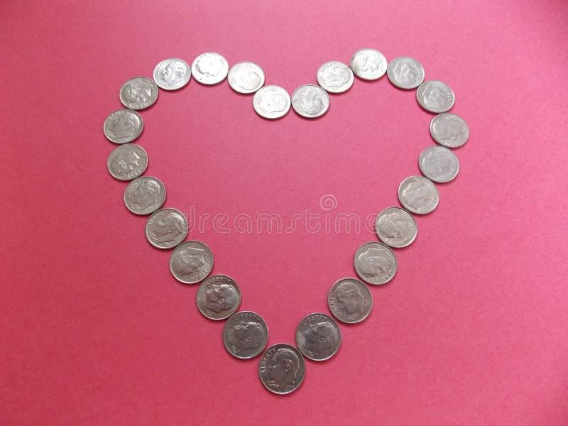 Monete da dieci centesimi di dollaro di amore fotografia stock