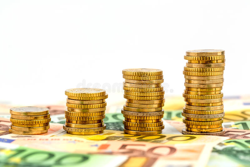 Monete della pila, curva in aumento immagine stock libera da diritti