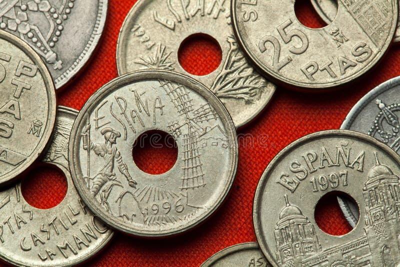 Monete della Spagna Don Quijote e mulino a vento fotografia stock