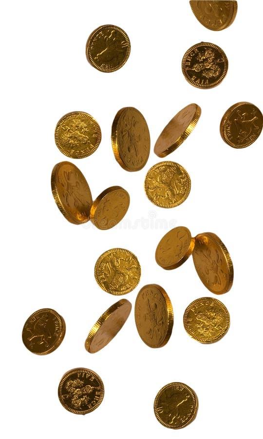 Monete di caduta del cioccolato dell'oro immagini stock