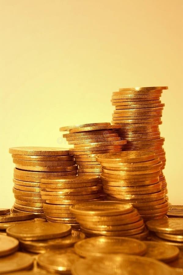 Monete dorate fotografie stock libere da diritti
