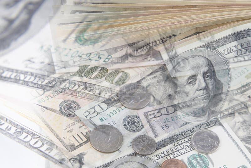 Monete e banconote americane immagini stock