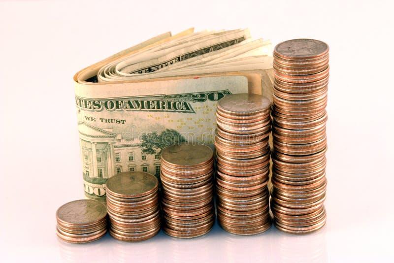 Monete e contanti fotografia stock