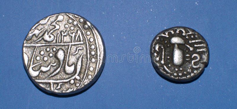 Monete indiane antiche fotografie stock