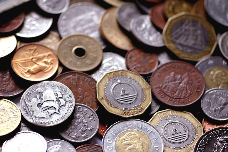 Monete internazionali immagine stock libera da diritti