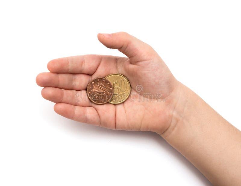 Monete in mano del bambino fotografia stock