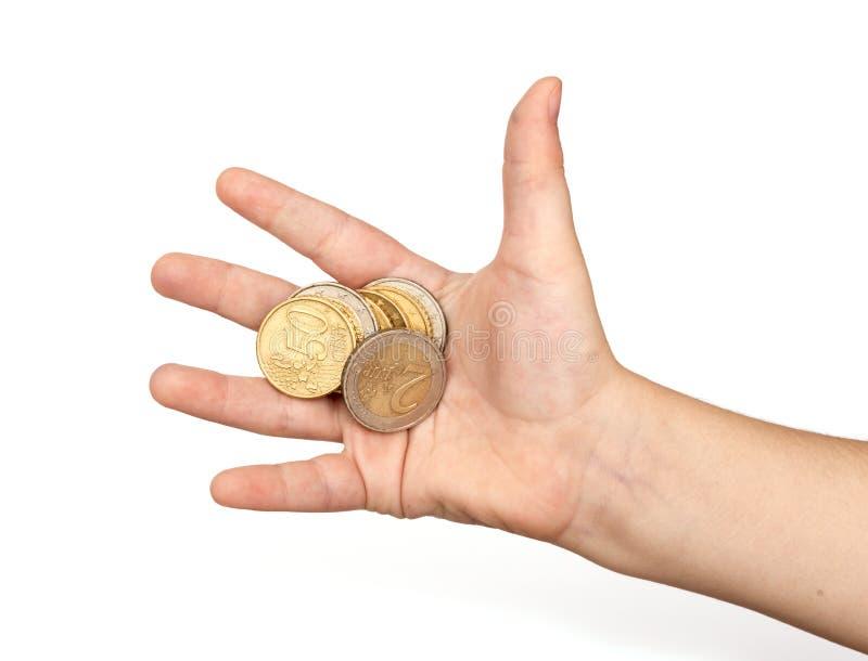 Monete in mano del bambino fotografie stock