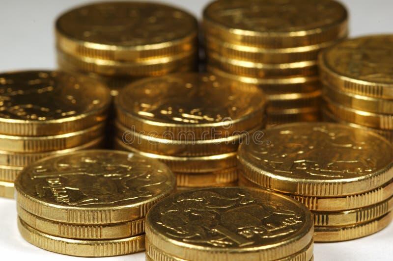 Monete in pile fotografia stock