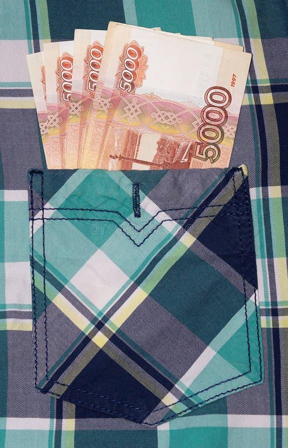 Monete russe sulla millesima fattura cinque fotografia stock libera da diritti