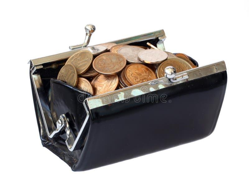 Monete in una borsa fotografia stock