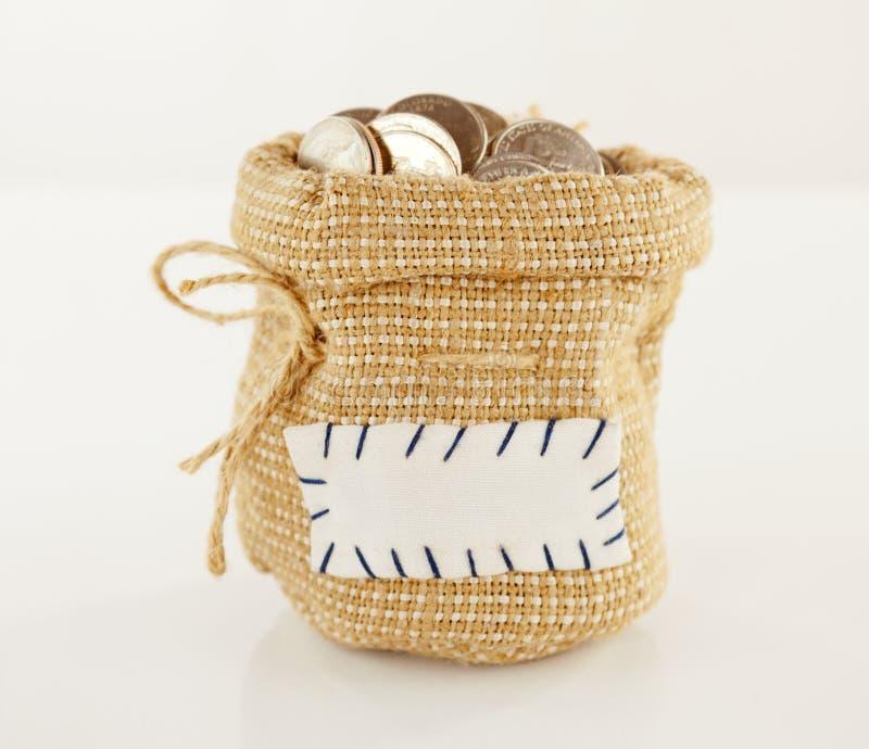 monety folujący worek fotografia stock