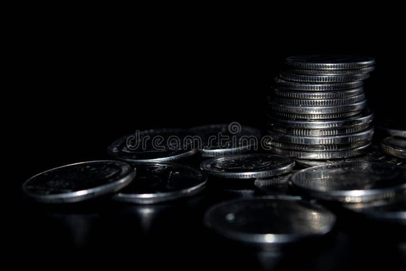 Monety na czarnym tle fotografia stock