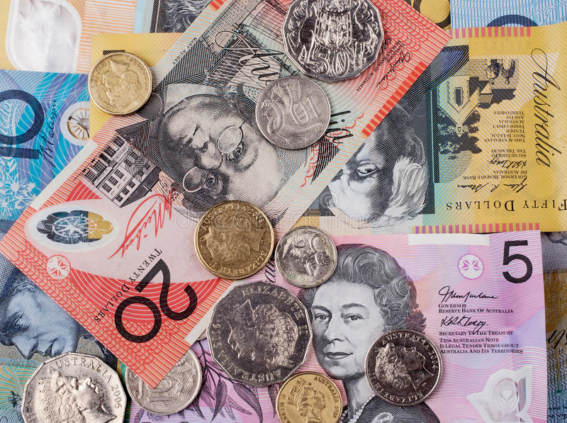 Money. Bank notes and coin australia as a finance background royalty free stock images