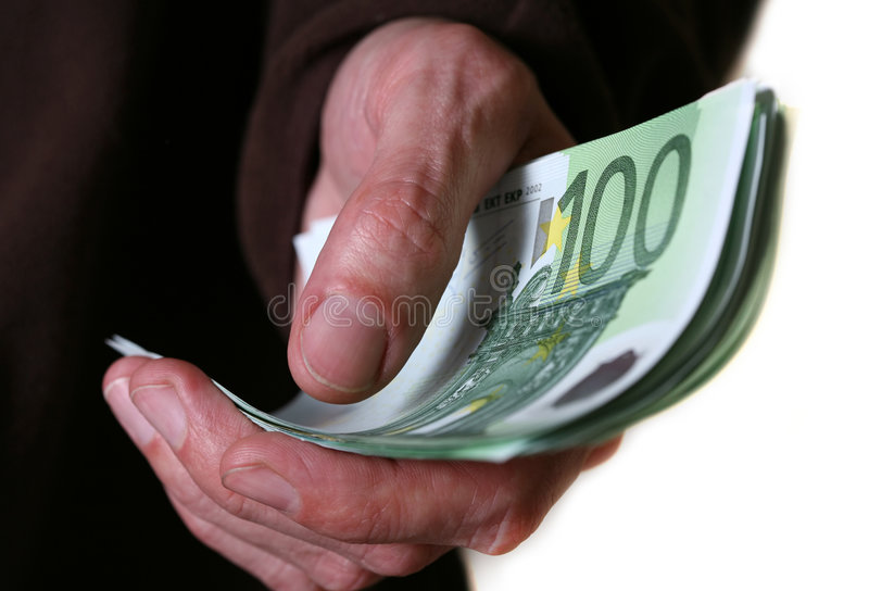 Money. Hand giving Euro banknotes money stock images