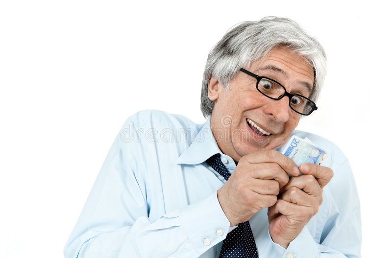 Money. Gray-haired greedy businessman with banknotes in his hands royalty free stock photos