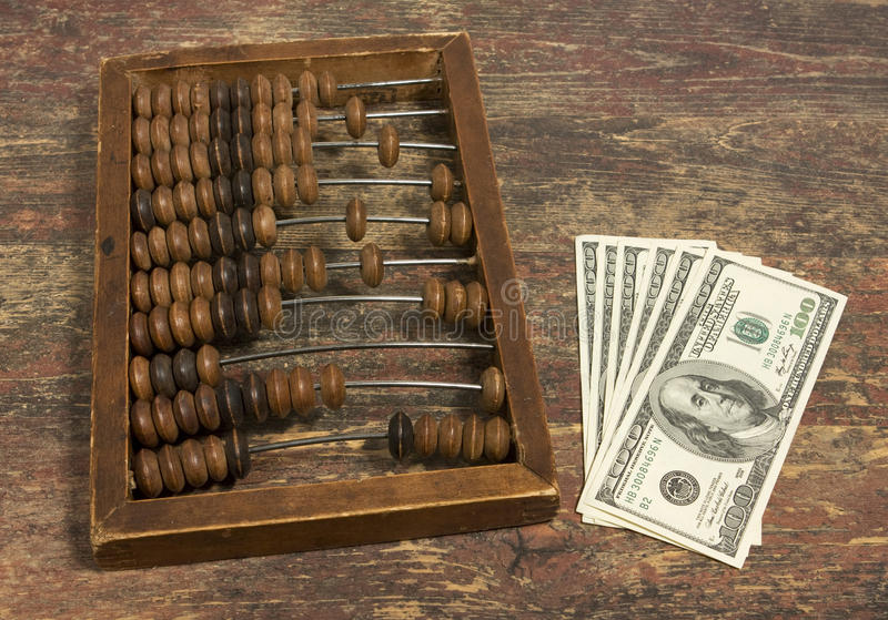Money and abacus royalty free stock photo