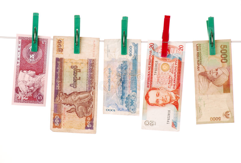 Money of asian countries. Banknotes of China, Myanmar(Burma),Cambodia, Philippines, Indonesia on a rope. Attached with clothespins. Concept for  Money royalty free stock photos